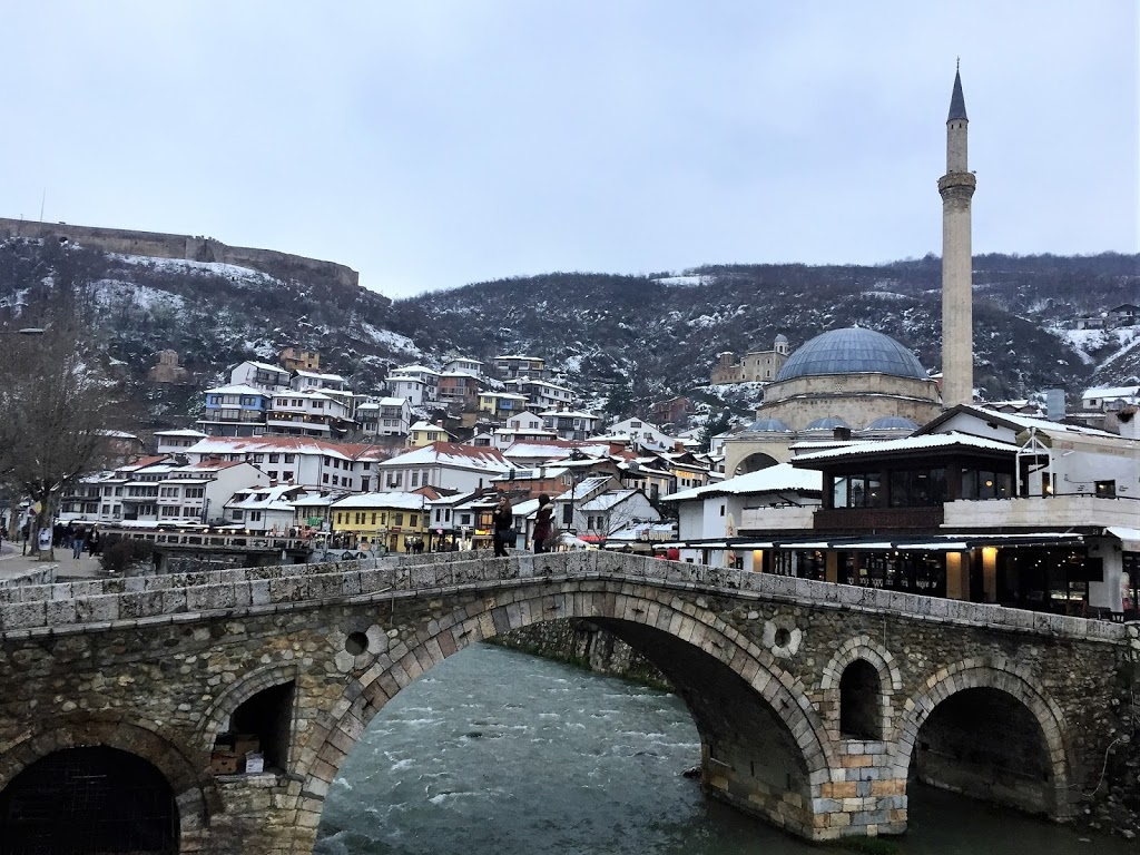 Prizren's bridge of promises, and in the evening, the lights in the bars and cafes bring the town together in their soft, warm glow.